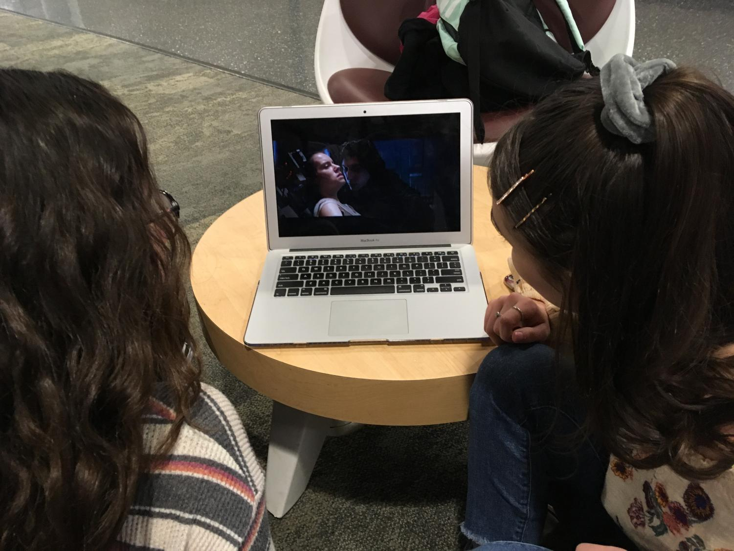 "While spending free time at school, freshman Clarissa Theiss and junior Ella Simpson watch part of  Star Wars: The Force Awakens. Science-fiction movies and shows have been defying gender roles and breaking stereotypes for decades. ""I think that sci-fi films like Star Wars or action movies are more valuable for girls to watch; they are realistic in the sense that they empower women,"" Simpson said."