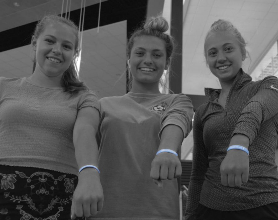 Soccer girls posing with #JackStrong bracelets.