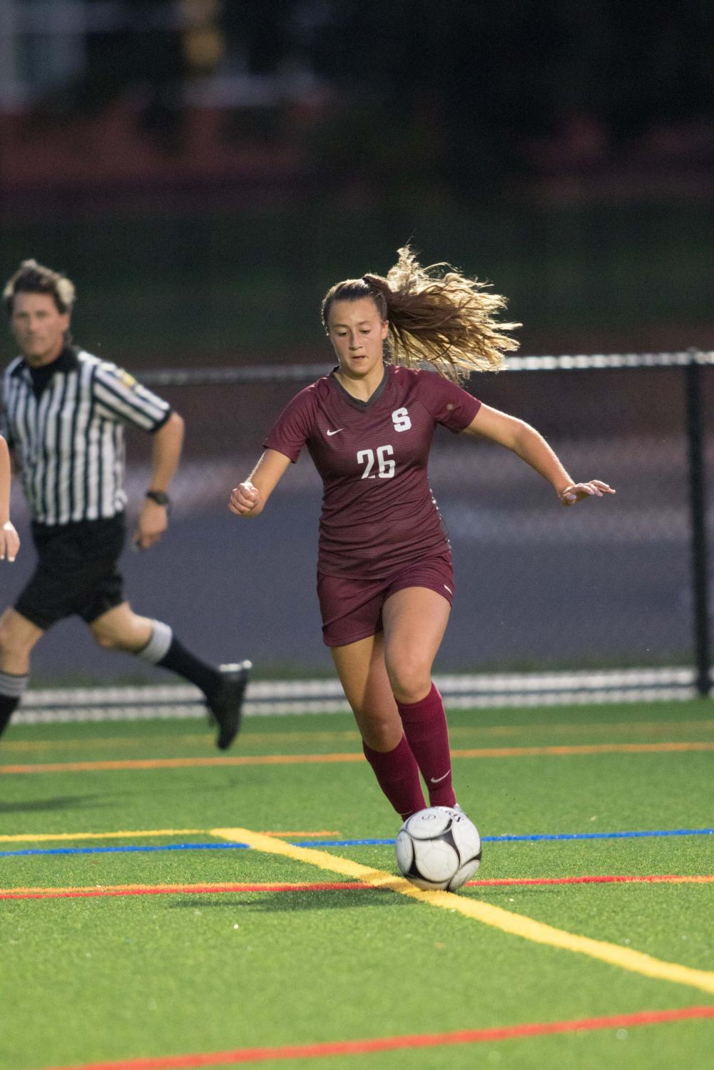 """Senior Megan Stoltzfus moves the ball up the field at the girls soccer game on September 10th. The team defeated Red Land 2-1. """"I think it depends how much work you put into it, and I think going into the second half, our team had the mindset that we were going to work hard and we were going to win."""" Photo Courtesy of Michael Houtz"""