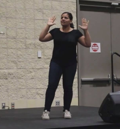 Gigi Gallegos taking part in a sign language competition.