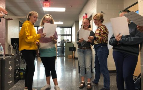 """(From left to right) Katelyn James, Leslie Neal, Mariele Wassom, Maribeth Kelly, and Rachael Rhoades. Glee Club participants practice a song at their meeting last Friday. """"Expect fun, positive vibes!"""" James said. """"It's honestly one of the most fun things I do at this school. I love being a part of the club."""""""