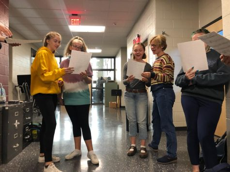 "(From left to right) Katelyn James, Leslie Neal, Mariele Wassom, Maribeth Kelly, and Rachael Rhoades. Glee Club participants practice a song at their meeting last Friday. ""Expect fun, positive vibes!"" James said. ""It's honestly one of the most fun things I do at this school. I love being a part of the club."""