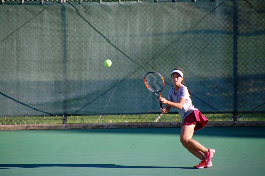 Quiana+Guo%2C+freshman%2C+plays+singles+during+the+State+High+Girls+Tennis+Teams%E2%80%99+semi-final+district+match+against+Hollidaysburg.+Quiana+describes+what+she+learned+during+her+first+year+on+the+team.+%E2%80%9CI+feel+like+another+thing+I%E2%80%99ve+learned+is+that+the+people+on+the+team+are+willing+to+help+no+matter+what.+It+is+just+so+nice+and+helpful+to+know+that+20+some+people+will+always+be+there+to+back+you+up%2C%E2%80%9D+Guo+said.+%0A%0A