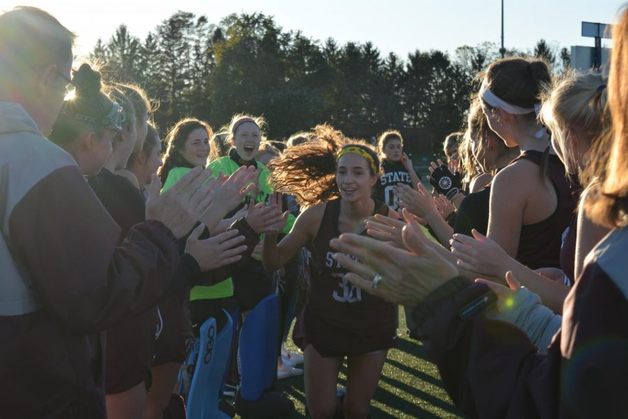 Johannah+Lee+runs+down+the+tunnel%2C+high-fiving+her+teammates.+%E2%80%9CThere+was+lots+of+screaming+and+cheering+on+the+sideline%2C%22+Miranda+Morrison%2C+sophomore%2C+said.+%22It+was+very+energetic.%22+The+tunnel+is+a+tradition+the+team+does+every+game.+