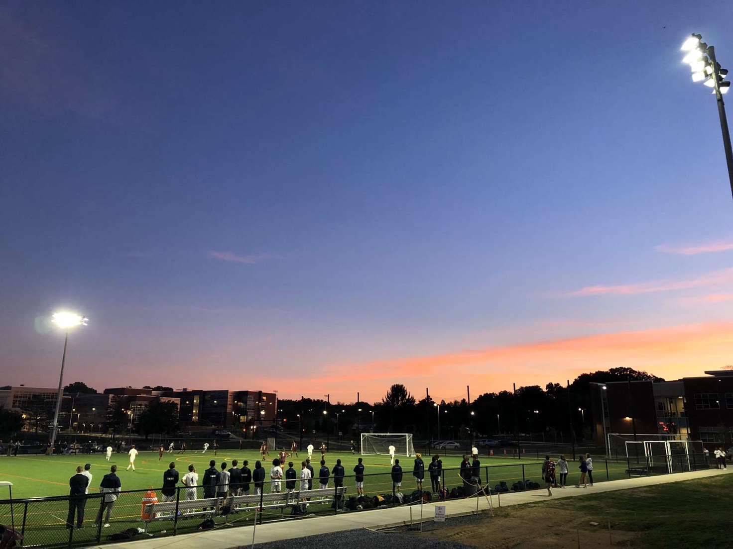 """The sun setting on North Turf Field at State High. This is to represent the """"uneven"""" playing field of athletics. Cristen Barnett, a senior on the Temple Field Hockey team, spoke out about the cancelled Field Hockey game in an interview with The Philadelphia Inquirer. """"It's telling us that these fireworks and setting up for a football game are more important than finishing a Division I contest,"""" Barnett says."""