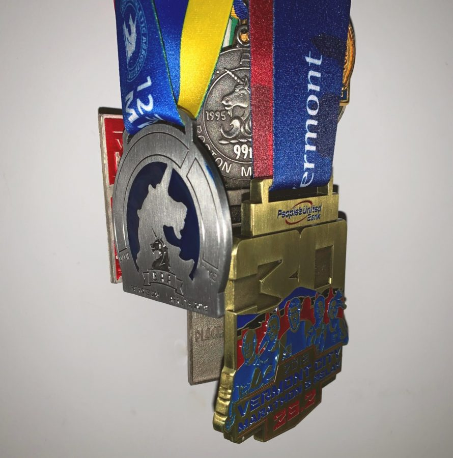 A group of medals from marathons. This is to represent the many marathons Eliud Kipchope has run. Kipchope has entered 13 official marathons.