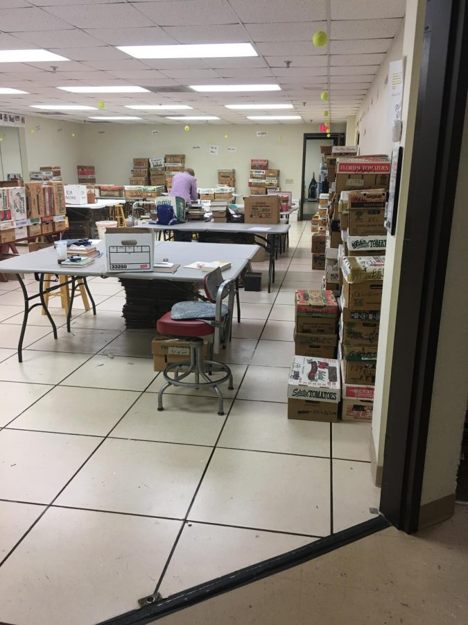 "Sue Hiester, the lead book sorter, arranging previously sorted books into boxes they will remain in until the sale in May. ""We wouldn't exist if the community were not as generous as it is in terms of giving us donations,""  Hiester said."