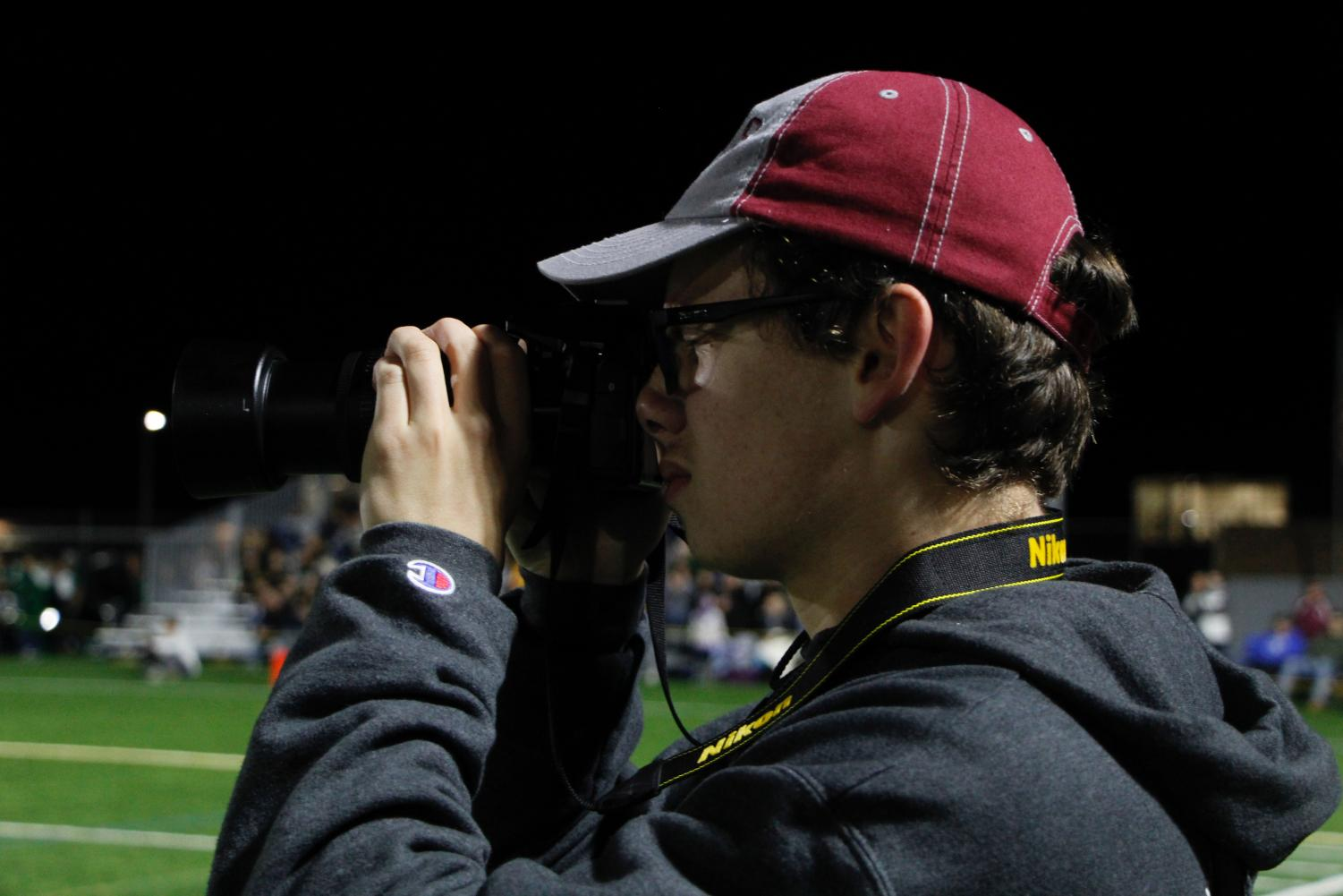 Caleb Craig, photographer, gets ready to snap an action shot of the State High vs. Central Dauphin game.