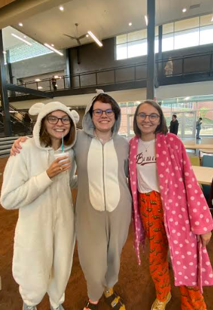 Sydnee Rockey, Emma Rockey and Mac Campbell participate in pajama day during spirit week.