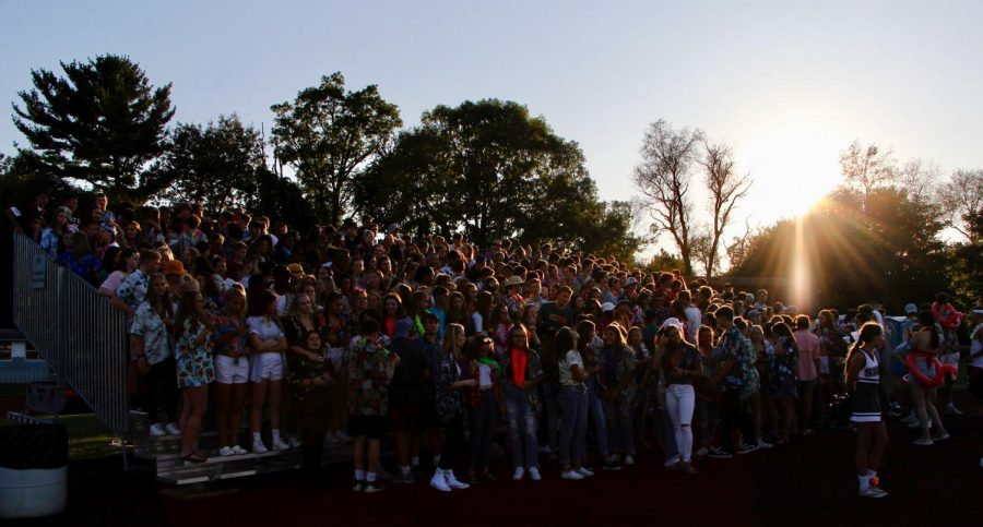 "State High students pack the stands at the first game of the football season. Renovations at Memorial Field have relocated fall field sports to the north and south tracks. Students have mixed feelings about the adjustment. ""I don't think there's the same energy that Memorial had,"" Zane Saylor, senior, said."