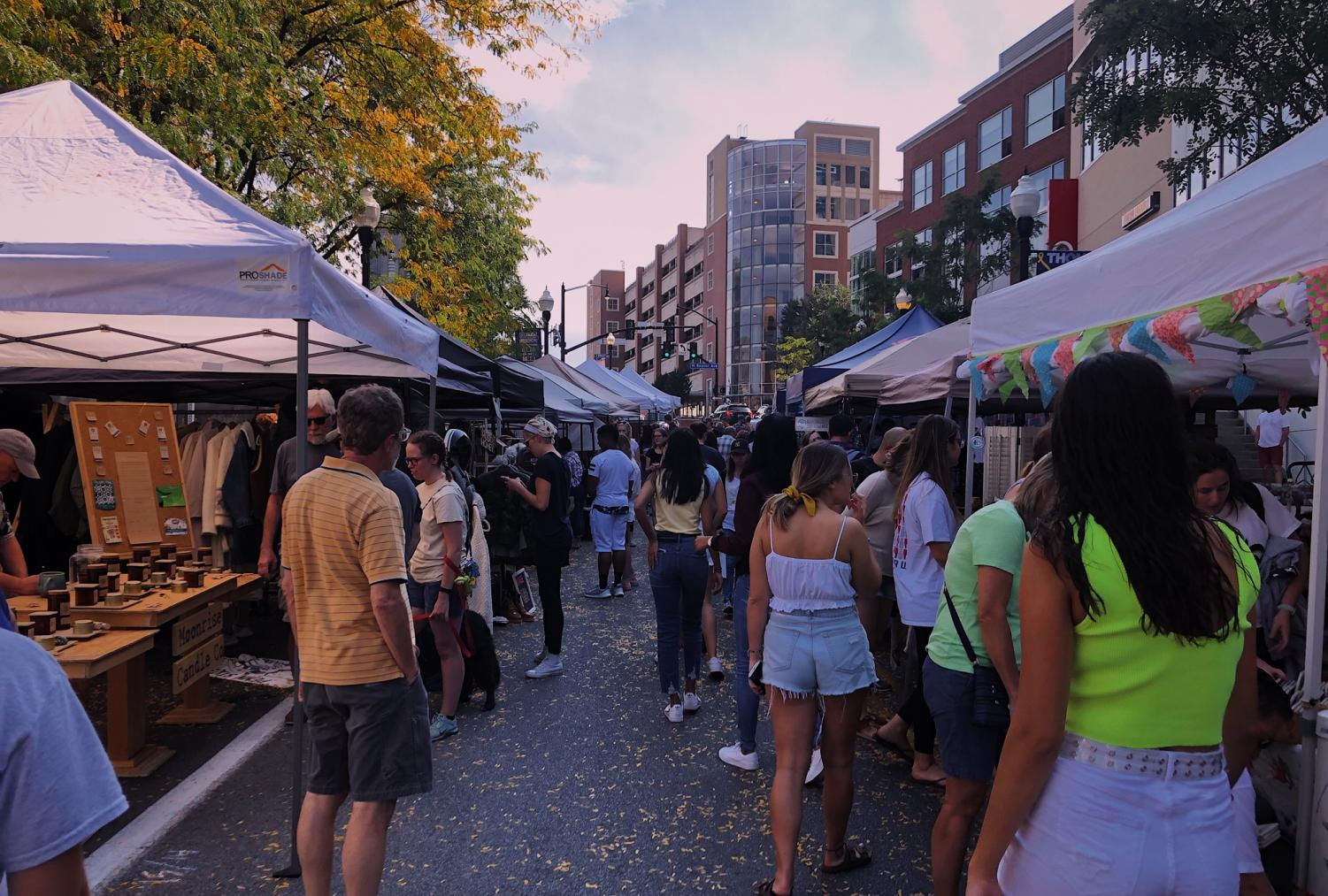 """Many different people walk and shop at vendors booths. """"I've walked by Pop-Up Avenue a couple times but this is the first time I've spent time looking at the vendors,"""" Sarah Koenig, a State College resident, said. Pop Up Avenue took place September 28th."""