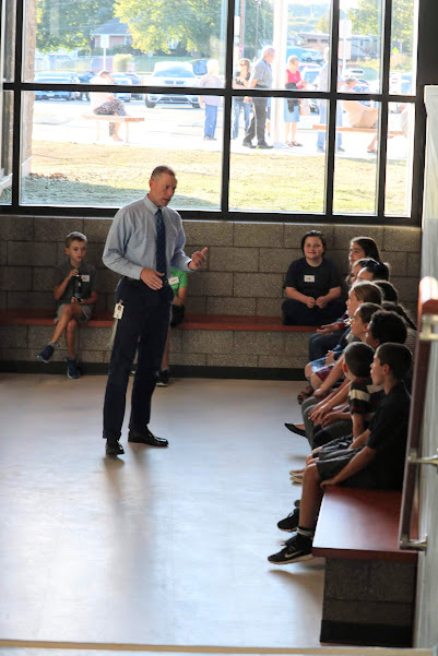 Before community members begin to enter the school, Principal Todd Dishong instructs the fifth grade ambassadors to look people in the eyes and shake hands firmly when welcoming people in.