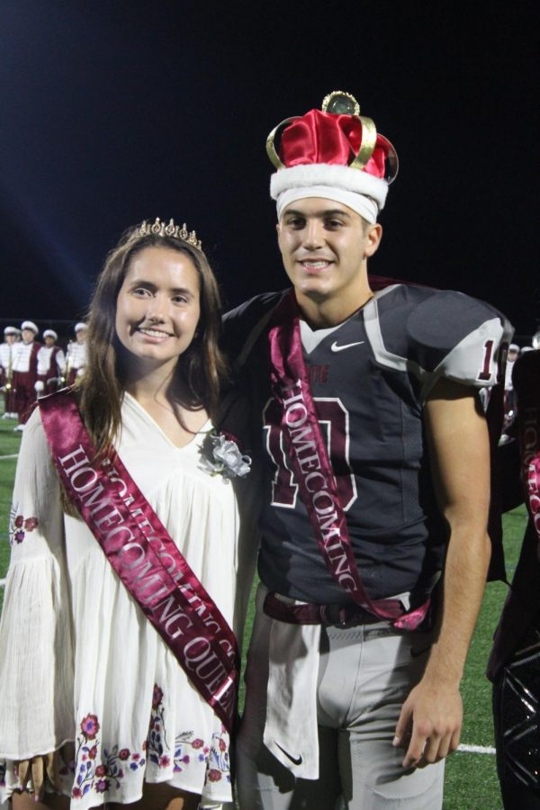 Seniors Alison Houtz and Brady Dorner smile wide for their photo. They were both crowned Homecoming King and Queen. I think it made it a lot more fun that we got to do it together, Houtz said.