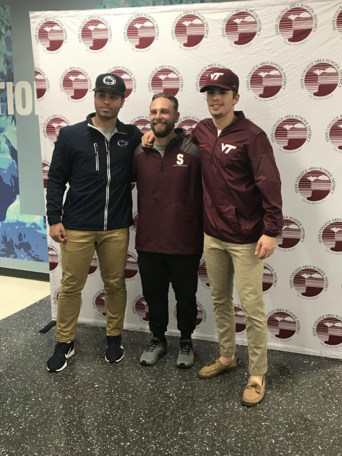 "Officially signed seniors Jack Hurley and Joe Nastasi, decked out in their future college garb, pose for a photo with State High varsity baseball coach Jeremy Dinsmore. Hurley and Nastasi were joined in signing their National Letter of Intent to play division I college sports next year by Matthew Brownstead and Zachary DeCarmine. ""For them to share this early signing period as a coach is an awesome feeling just because you get a chance to see them cherish this moment together,"" Dinsmore said."