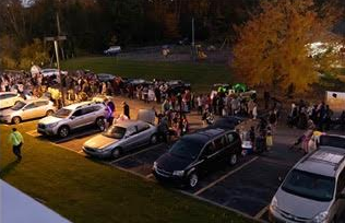 Families gathering at State College Assembly of God for a fun night at Trunk-or-Treat.
