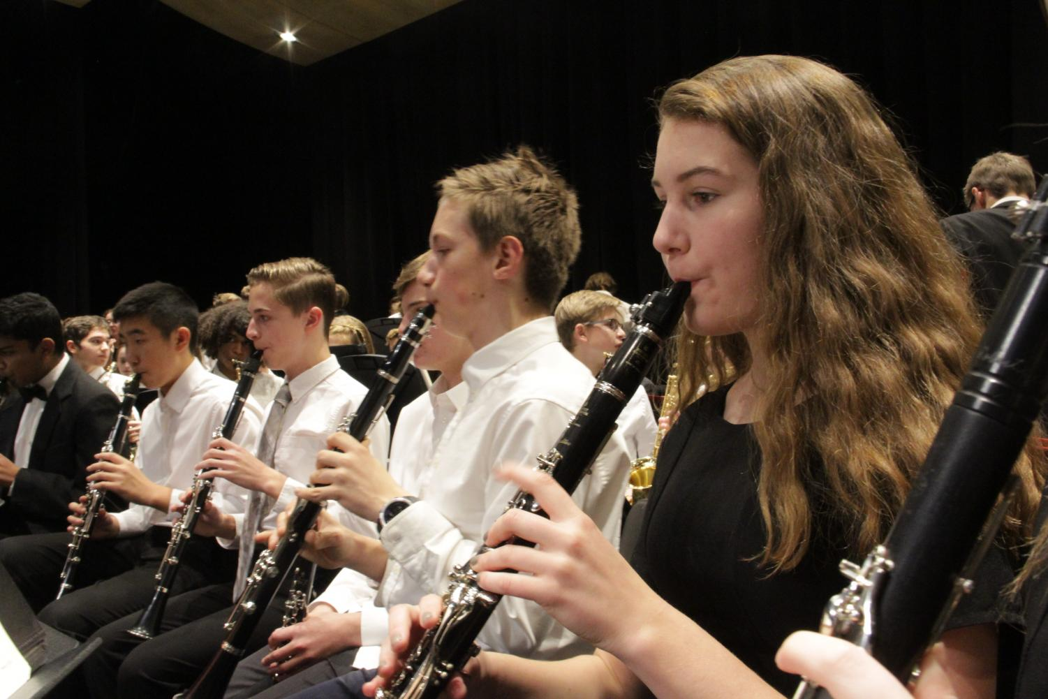 "On Wednesday, November 6th, the State High Bands came together for their first concert of the year. Sophomore Nika Kello, a member of State High's Symphonic Band, warms up for the band concert on her clarinet. ""I had a wonderful experience at this concert. It was amazing to display the product of our hard work at many hours of rehearsals to our friends, family, and other music students,"" Kello said."