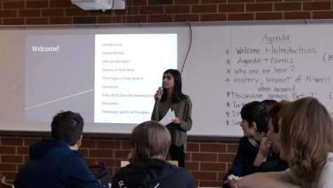 Rija Sabeeh, junior and Peer Advocate, starts the forum off with an opening statement. Sabeeh let students who were there know what they were going to be doing while they were there and how the forum would run. Also pictured in the photo is an agenda, laying out the forum, making it easy for students to understand what would be happening throughout.