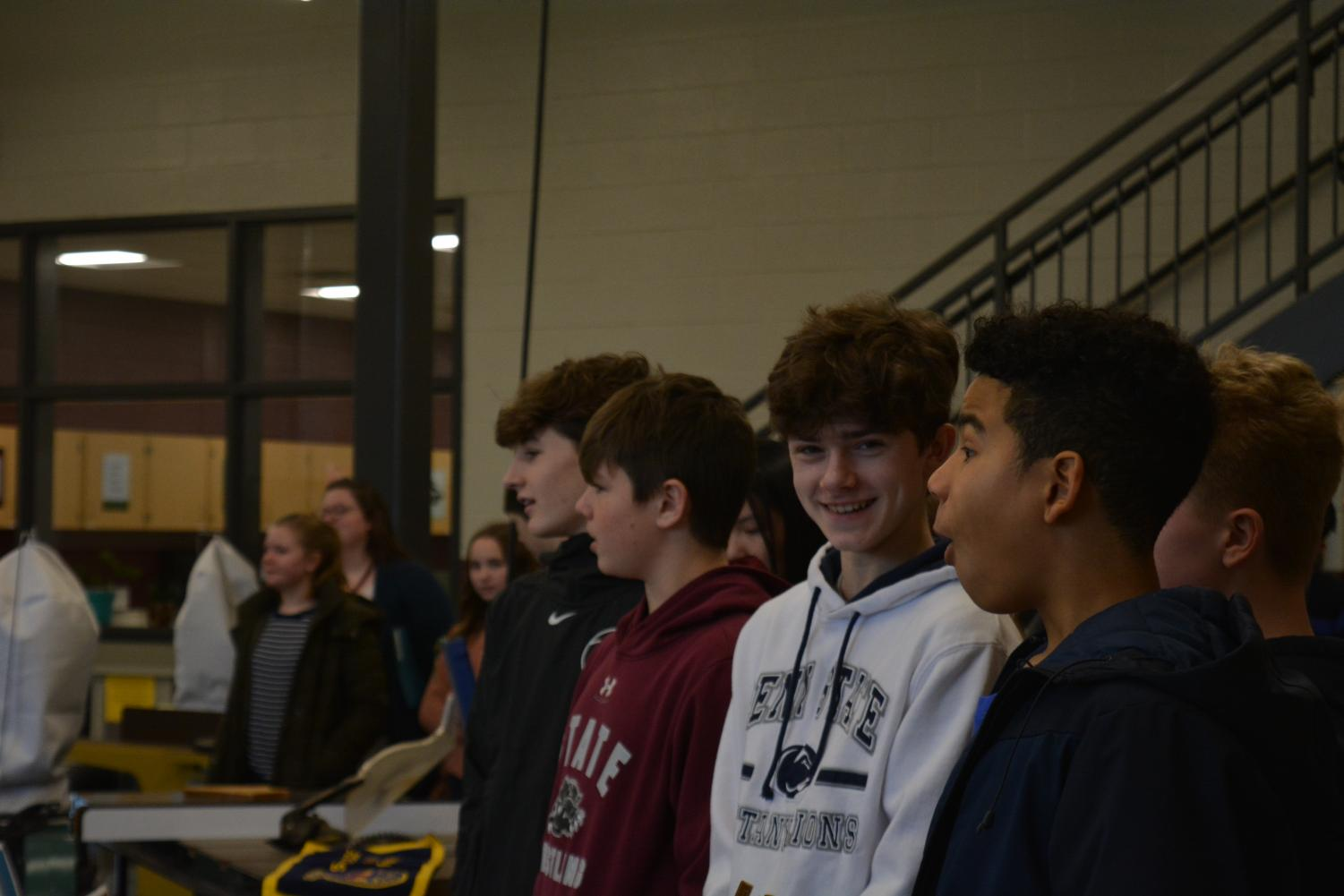 "8th graders Owen Yerka, Jake Dynan, Nathan Alexander, and Ian Marshall watch the agricultural sciences presentation. ""I'm very excited for all of the different choices of electives because there's a lot of opportunities for us,"" 8th grader Ian Marshall said. Many of the students enjoyed the presentations from the different CTC courses."