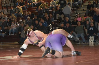 "Junior Harrison Schoen grapples with his opponent in the 285 lb weight class in Thursday's home meet against Mifflin County. State High lost the match 36-29 despite mounting a comeback after being down 29 points at intermission. ""We lost, but our guys wrestled their hearts out,"" sophomore Luke Banker said."
