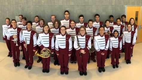 "State High band, including 12 seniors, 4 juniors, and 8 sophomores, poses in uniform. ""I believe State High took 24,"" sophomore Tanner Deyo said.  ""Of those 24 I think 21 qualified to go the regionals."""