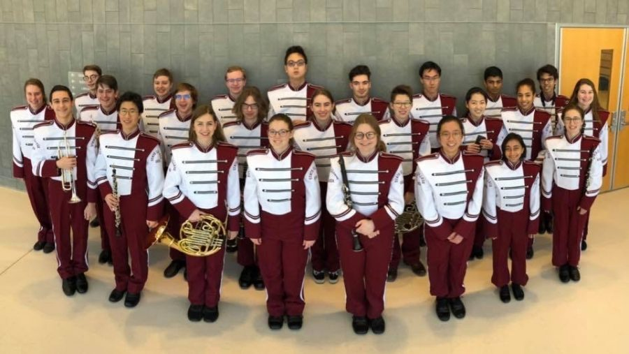 State High band, including 12 seniors, 4 juniors, and 8 sophomores, poses in uniform.