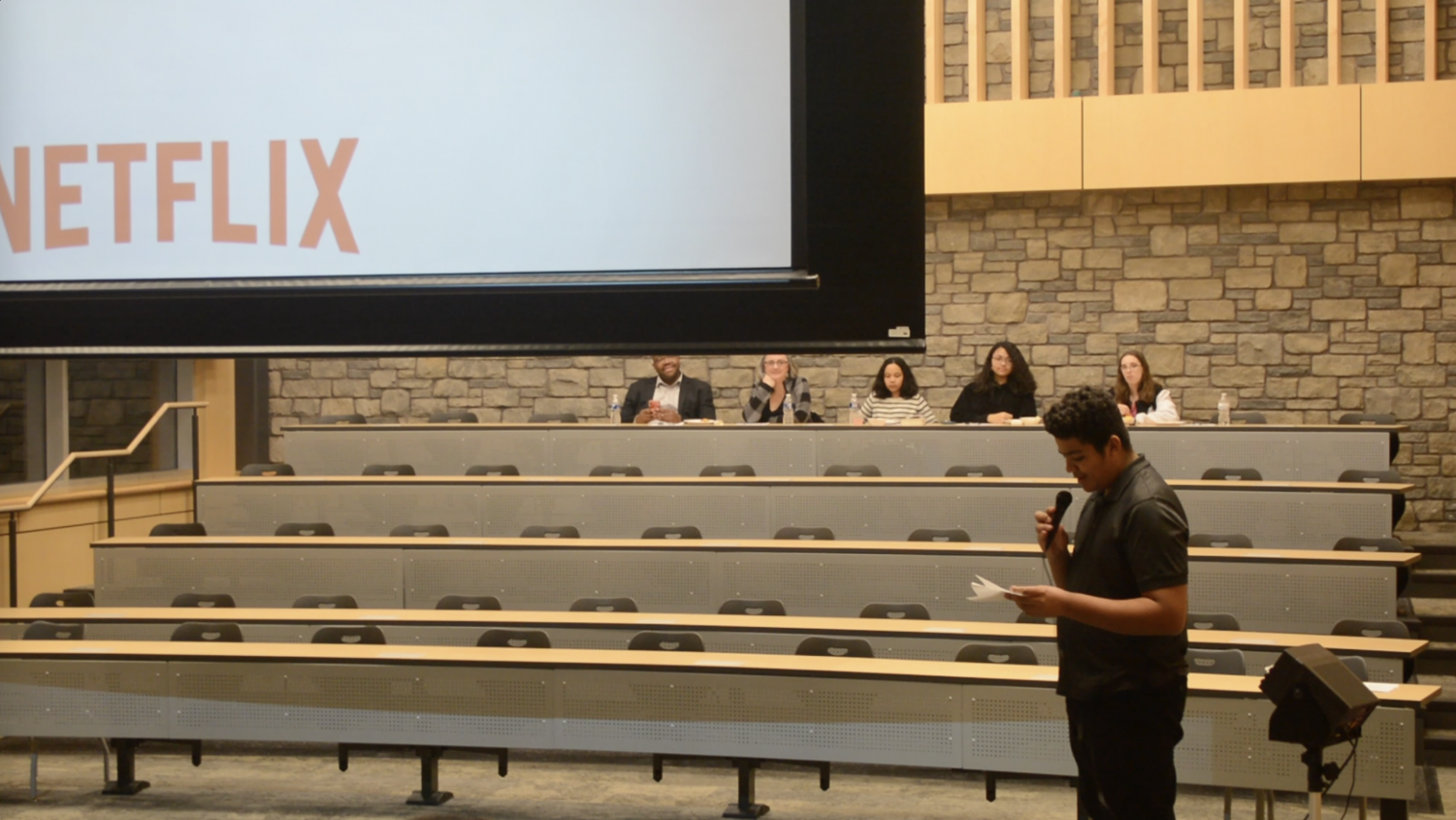 """Aidan Kennedy-Phillips, a sophomore at Delta High, introduces his Community Action Plan project. He chose to show the Netflix documentary '13th.' He opened by saying, """"I'm glad you could all be here tonight, this is such an important film about the mass incarceration crisis in the United States."""""""