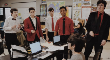 (Left to right): Elijah Snyder, Nicholas Cole, Ethan Hardyk, Ronit Patel, Franki Dorman surprise a freshman student with a vocal valentine and getting the class into the Valentine's Day spirit.