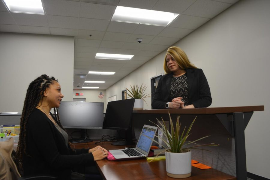 """REACT would really like to get involved with more education, that can happen building-wide, so we can work toward not only responding to issues of bias but preventing issues of bias,"" Dr. Seria Chatters (right) says. Here Deanna Burgess (left) and Chatters discuss issues relating to equity as leaders on the REACT Team."