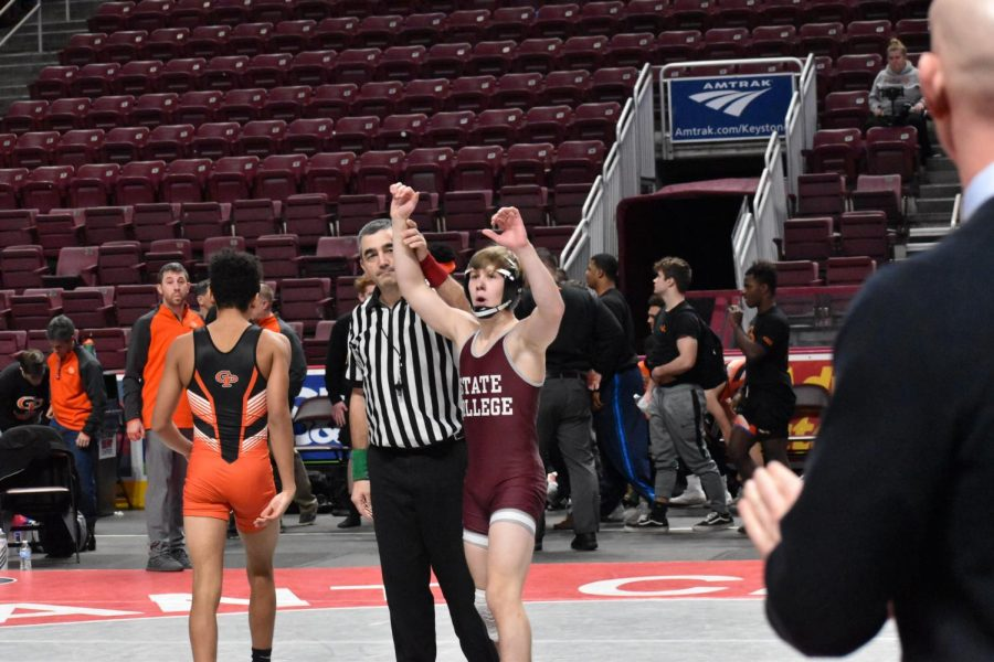 "Freshman Eric Weaver celebrates after his win against Erie Cathedral Prep. Weaver pinned his opponent in the second period to give State College a 24-22 lead. ""The wrestling team becomes your family,"" Weaver said. ""We pick on each other a lot but I know that we are all there and will support one another all the time."""