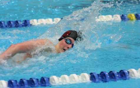 """During the District 6 Championships from March 27th to 29th, freshman Ty Uhlig competes in the boys' 500 yard freestyle. Uhlig won his race, one of the many athletes who helped the swimming and diving team win the District Championships. """"It feels good being a freshman and going to States. [Coach] Marion [Ulmer]'s training really helped me,"""" Uhlig said."""