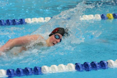 "During the District 6 Championships from March 27th to 29th, freshman Ty Uhlig competes in the boys' 500 yard freestyle. Uhlig won his race, one of the many athletes who helped the swimming and diving team win the District Championships. ""It feels good being a freshman and going to States. [Coach] Marion [Ulmer]'s training really helped me,"" Uhlig said."