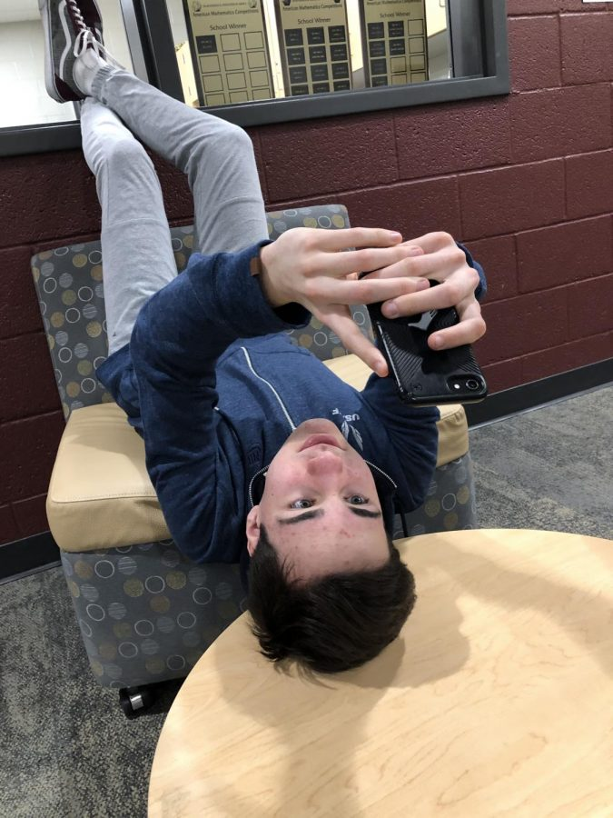 "Reece Steidle, a freshman, uses his phone often. ""I understand that there are dangers when it comes to the internet, but it is also really helpful,"" he said. Global teenage phone use raised this year to 89% of all teens."