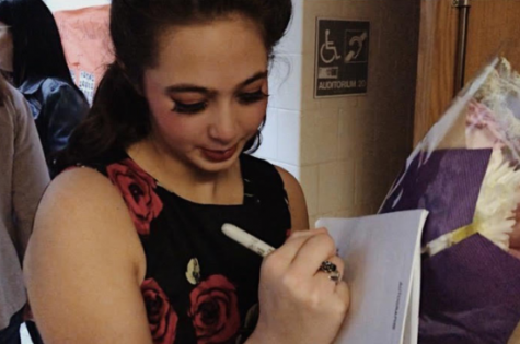 Bella Poher, actress of Rosie, signing a playbill of an audience member after the closing show.