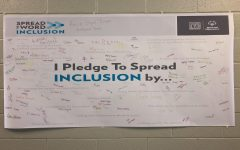 "Many State High students signed the ""Spread the Word Inclusion"" poster during school. ""We had the poster for people to sign showing that they believe in inclusion and that they will do something to promote [inclusion] in the school environment,"" Mrs. Percival said."