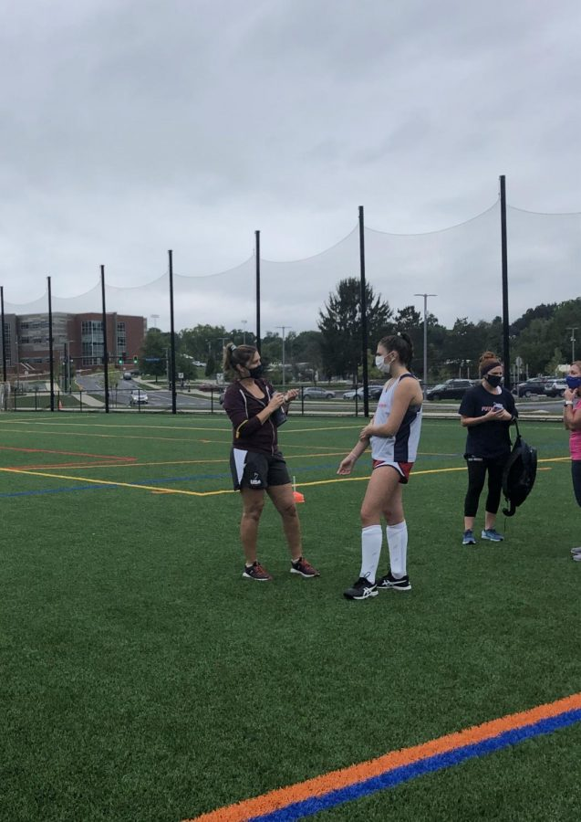 Sharon Herlocher, head coach of the State High Field Hockey team, talks to athlete Olivia Morocko before practice on Thursday, September 3rd in State College, PA.