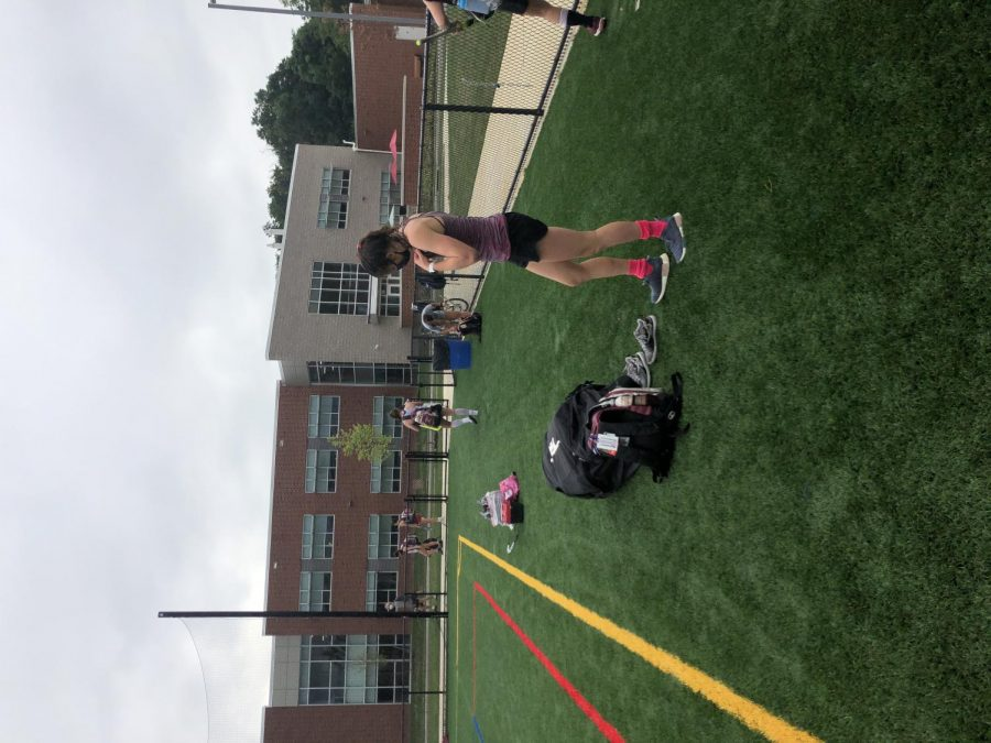 Molly Schreiner, a sophomore at State High and goalie on the field hockey team puts her gear away after a successful practice, Thursday, September 3rd in State College, PA. (Photo/Hannah Garlin).