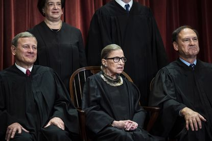 Ruth Bader Ginsburg sitting while posing for a Supreme Court picture on Nov. 30, 2018.