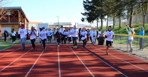 Runners begin the 5K as the starter sends them off at the first DECA color run last year.