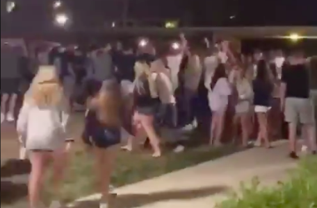 Penn State freshmen gather in large groups outside of East Halls on August 19, 2020. Despite the local town's ordinance concerning large gatherings and required face coverings, students were found to be gathering in large groups without masks as soon as they returned to campus.