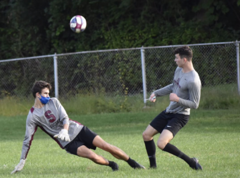 A soccer practice at Community Field in State College, PA, taken Wednesday, Aug. 9, 2020. Senior Ty Price shoots the ball at Sasha Mohoruk, senior and varsity goalie.