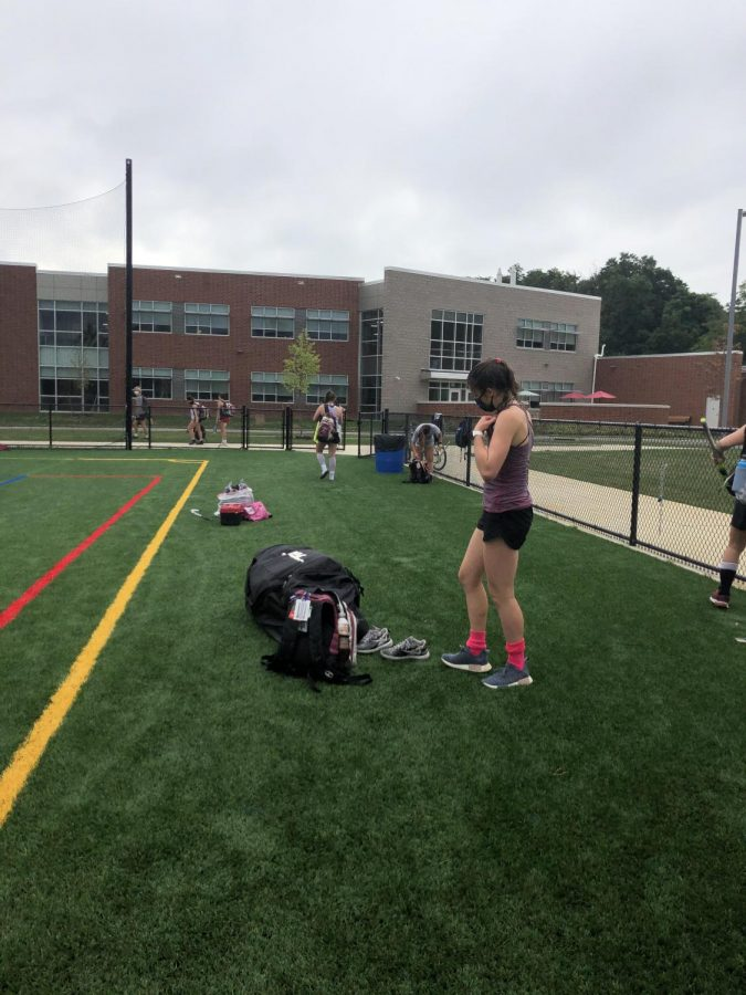 Molly Schreiner, a sophomore at State High and goalie on the field hockey team, puts her gear away after a successful practice, on Thursday, September 3rd in State College, PA. (Photo/Hannah Garlin).
