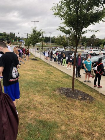 470 students wait to enter the SAT test administration outside State High on the morning of August 29, 2020.