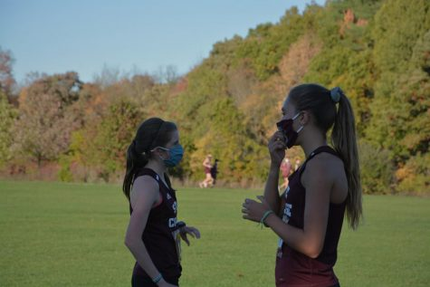 Seconds after crossing the finish line, senior Jordan Reed (left) and sophomore Marlee Kwasnica (right) wait for the rest of their teammates to complete their race in State College, PA, taken Oct. 13, 2020.