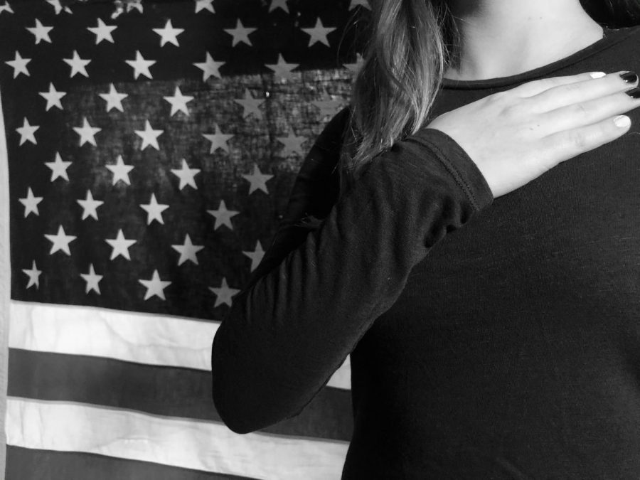 Photograph+taken+on+Nov.+17%2C+2020.+A+picture+of+a+young+girl+pledging+to+the+American+Flag.+