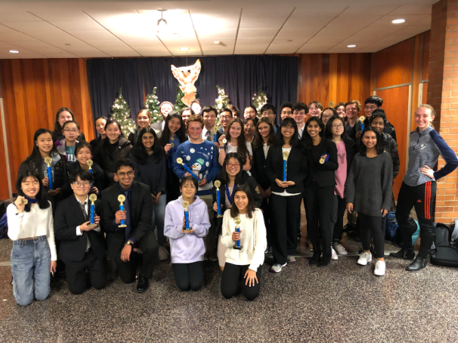 The State High Forensics Team pose with their awards after last year's tournament at La Salle, Wyndmoor PA, December 14. This year, the team had to compete virtually.