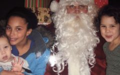 Kayanna Myers along with her family members celebrate Christmas in 2011 by visiting Santa Claus.