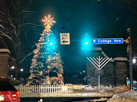 A lit up Christmas tree and a Menorah standing tall in downtown State College, on display for everyone to see.