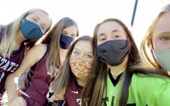 Players (left to right) Caitlyn Keiter, Madison Shomo, Quinn Colburn, Molly Schreiner, and Sage Newman of the State High field hockey team masked up for team pictures during the fall season. Team pictures, a highlight of each athlete's high school season, were just one of the many aspects that were forced to adjust due to COVID-19.