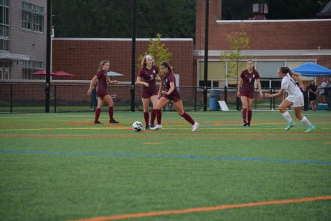 Junior Grace Lundy works with her teammates to get the ball out of their defensive end on Thursday, Sept. 9, at North Field in State College PA.