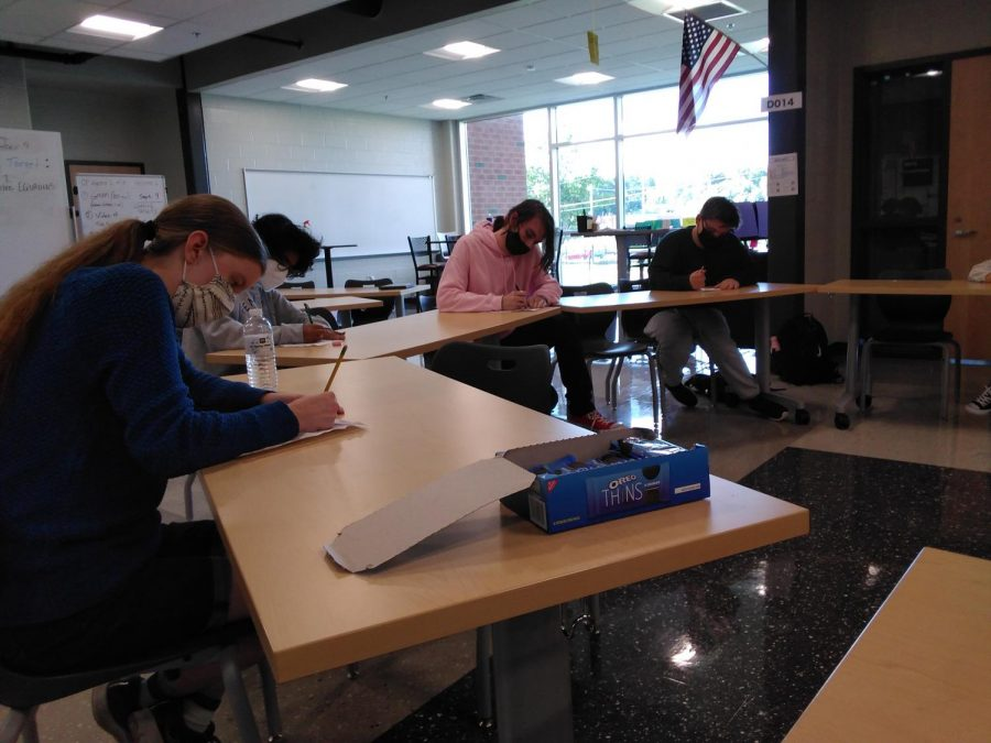 Students engage in a writing activity while at Acclivity Clubs first meeting in D012, on Sept. 9th, 2021.